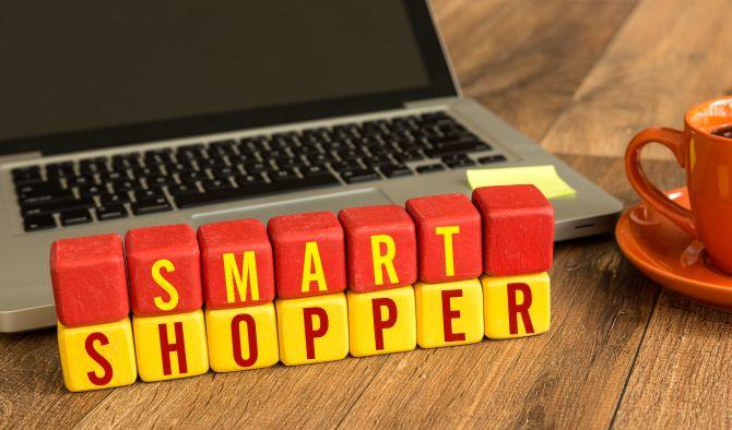 Smart Shopper written on a wooden cube in a office desk